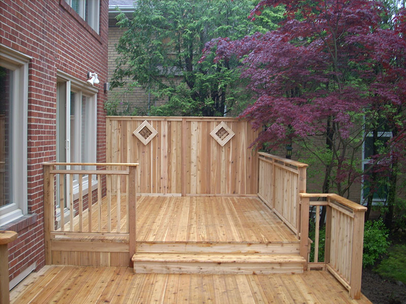 New wooden deck with handrails