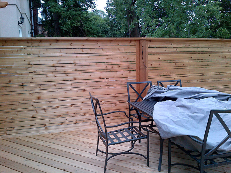 Wooden fences in with table and chairs 2