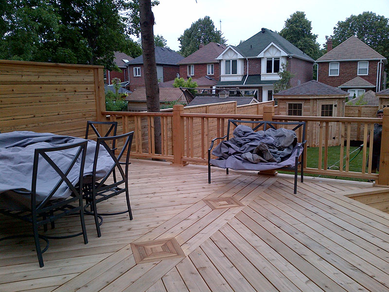 Wooden fences in with table and chairs
