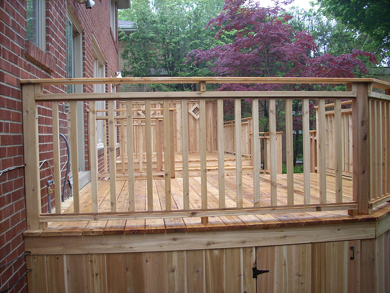 Wooden deck with handrails