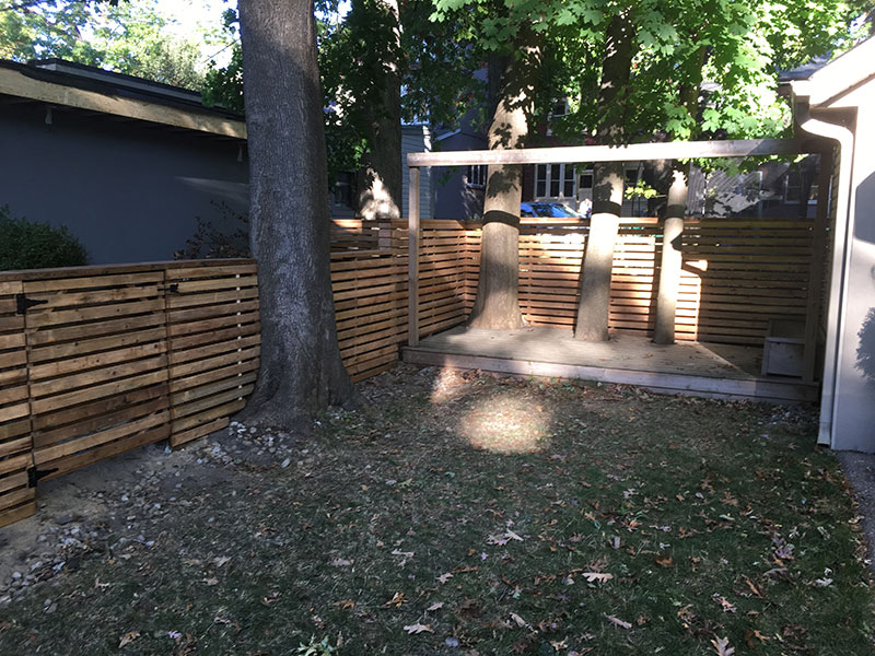New wooden fences over a tree
