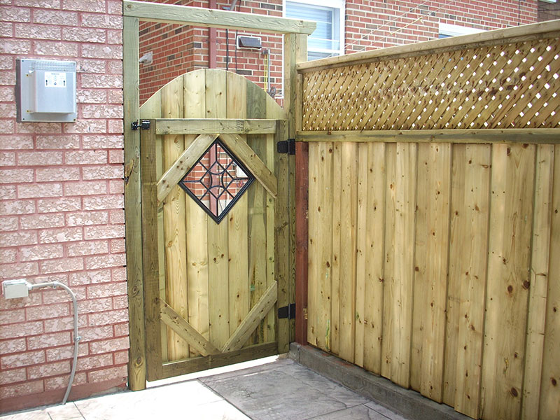 New wooden fences with door and locks with diamond shape window