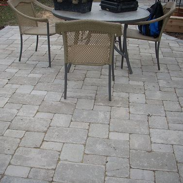 55 Interlocking in backyard with table and chairs 2