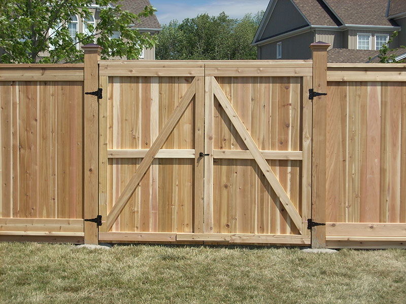 New wooden fences with doors